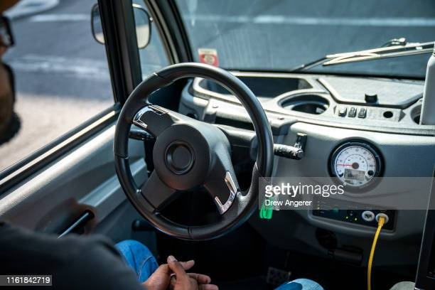 An Optimus Ride employee sits in the driver seat as he monitors the Optimus Ride autonomous sixseater shuttle bus as it drives through the Brooklyn...