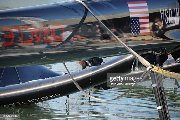 CONTENT] An Oracle team member walks along a capsized 72foot Oracle Racing catamaran before it is hoisted onto Pier 80 on Wednesday Oct 17 2012 in...