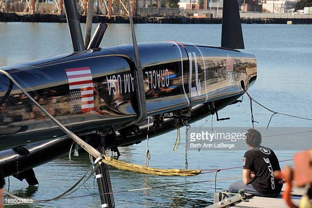 CONTENT] An oracle team member watches as a 72foot Oracle Racing catamaran is hoisted onto Pier 80 on Wednesday Oct 17 2012 in San Francisco Calif...
