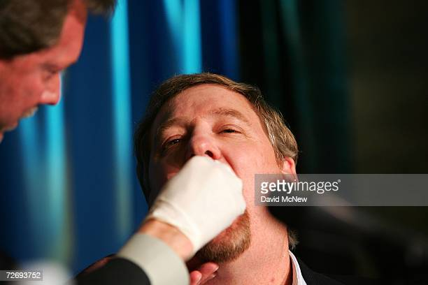 An oral sample is taken from Saddleback Church Pastor Rick Warren as he takes an HIV rapidtest during a press conference at the second annual Global...