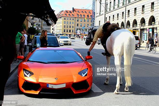 An orange aventador... With a police officer... Who give the aventador a parking ticket... While he is sitting on a horse...Lamborghini Aventador...