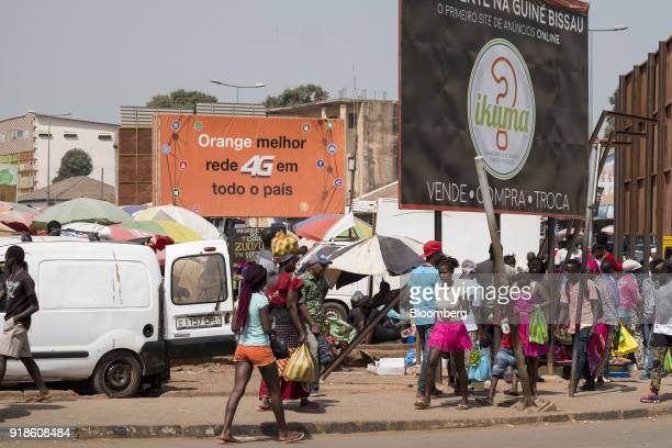 An Orange Bissau SA advertisement board stands at Bandim market in Bissau GuineaBissau on Monday Feb 12 2018 The International Monetary Fund said an...