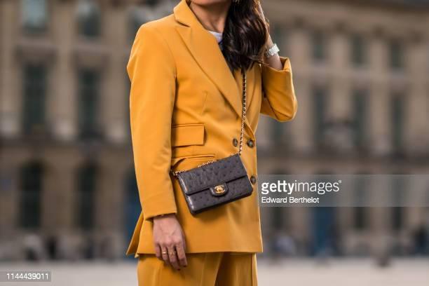 An orange blazer jacket a Chanel bag are seen on April 22 2019 in Paris France