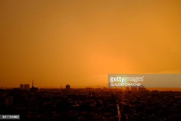 an orange color cast after the rain - claudio capucho stock photos and pictures