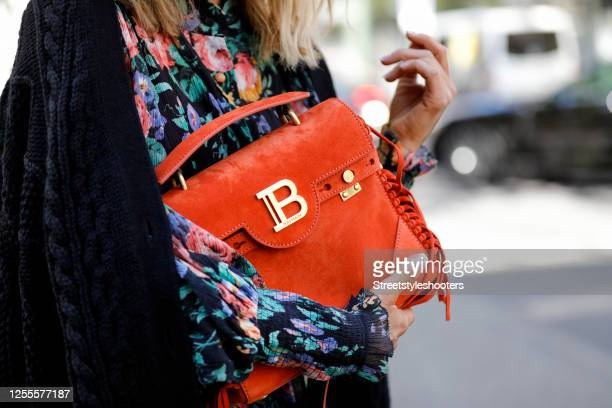 An orange colored bag by Balmain as a detail of influencer Gitta Banko during a street style shooting on July 10 2020 in Dusseldorf Germany
