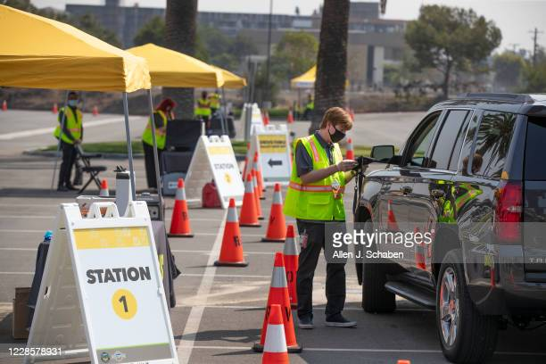 """An Orange County Registrar of Voters election services worker showcases voting in the drive-thru at the Super Vote Center Site"""" during a media event..."""