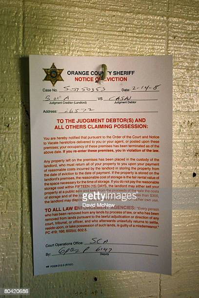 An Orange County Sheriff eviction notice hangs on a house to be sold in an upcoming 11day foreclosure auction of more than 1500 southern California...