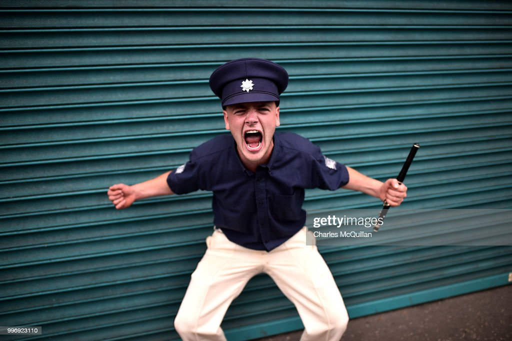 An Orange flute band member screams as the annual 12th of July Orange march and demonstration taking place on July 12, 2018 in Belfast, Northern Ireland. The marches across the province celebrate King William of Orange's victory over the Catholic King James at the Battle of the Boyne in 1690.