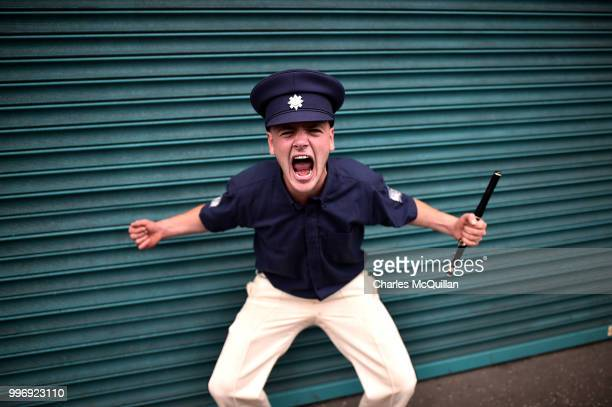 An Orange flute band member screams as the annual 12th of July Orange march and demonstration taking place on July 12 2018 in Belfast Northern...