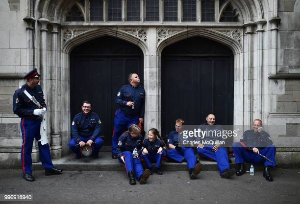 An Orange flute band take a breather as the annual 12th of July Orange march and demonstration taking place on July 12 2018 in Belfast Northern...
