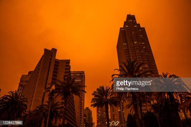An orange glow fills the sky above the Embarcadero as smoke from various wildfires burning across Northern California mixes with the marine layer,...