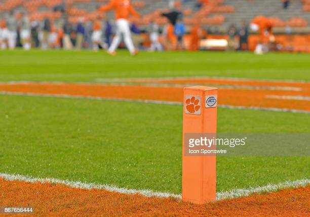 An orange goal line marker representing the ACC and Clemson Tigers is set in place during the Clemson Tigers game versus the Georgia Tech Yellow...