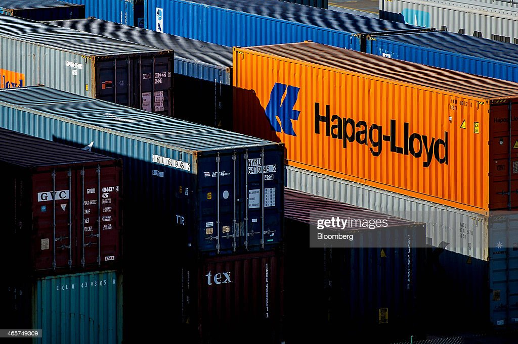 An orange Hapag-Lloyd AG branded shipping container stands on the quayside at the commercial port in Barcelona, Spain, on Wednesday, Jan. 29, 2014. Government bonds in Europe's most-indebted countries rallied in the first three weeks of the year on signs the debt crisis that pushed those nations' borrowing costs to euro-era records had abated. Photographer: David Ramos/Bloomberg via Getty Images