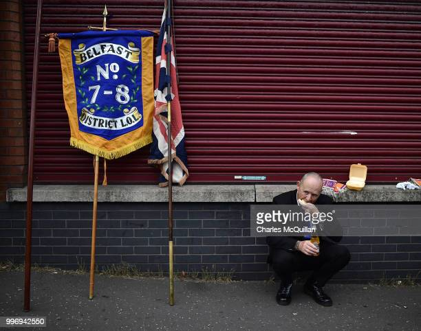An Orange man enjoys a burger before the start of the annual 12th of July Orange march and demonstration takes place on July 12 2018 in Belfast...