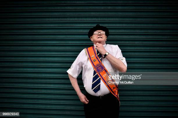 An Orange man fixes his tie before the off during the annual 12th of July Orange march and demonstration takes place on July 12 2018 in Belfast...