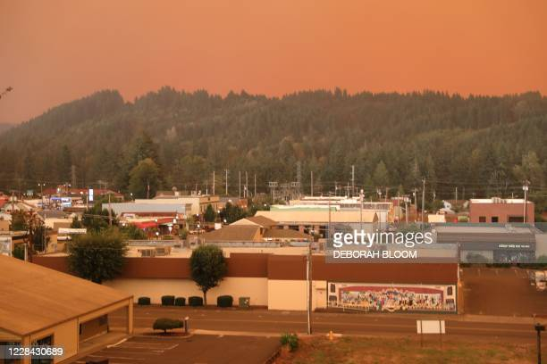 An orange smoke-filled sky is seen above Estacada, Oregon, on September 9 as fires burn nearby. - Hundreds of homes including entire communities were...