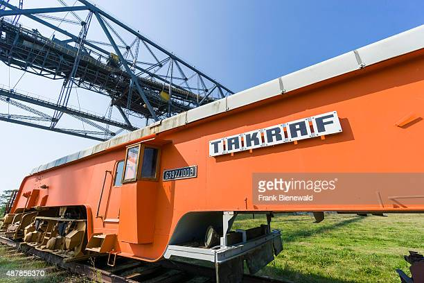 An orange Track Moving Machine of the company Takraf used in brown coal opencast mining to shift railway tracks a part of the stripping shovel F 60...