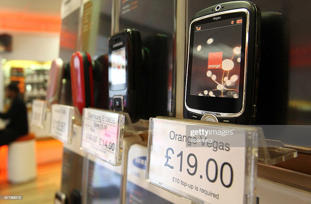 An Orange Vegas mobile phone, right, sits on display at a
