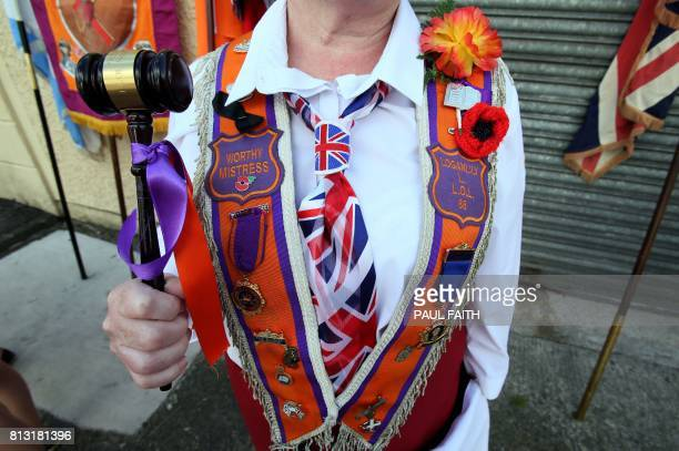 An Orangewoman is pictured taking part in the annual July 12 parade in Belfast, on July 12, 2017. - July 12 is the main marching day in the Orange...