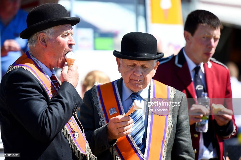 An Orangmen eat ice cream following taking part in the annual pre Twelfth of July parade held in Rossnowlagh on July 8, 2017 in Donegal, Ireland. The demonstration in Rossnowlagh is traditionally held the Saturday before the Twelfth of July parades across the border in the north of Ireland. The annual Orange marches and demonstrations celebrate the Battle of the Boyne in 1690 when the Protestant King William of Orange defeated the Catholic King James II on the banks of the river Boyne.