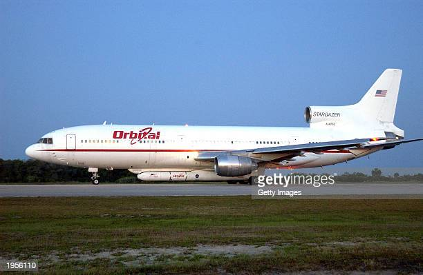 An Orbital Sciences' L1011 aircraft waits for takeoff April 28 2003 at Cape Canaveral Air Force Station Florida Attached underneath the aircraft is...