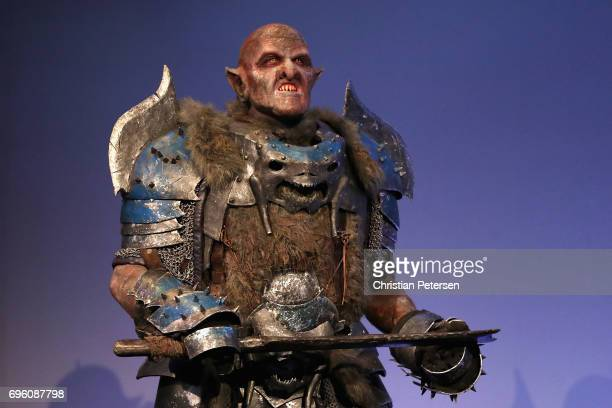 An orc charactor from 'Middle Earth Shadow of War' performs during the Electronic Entertainment Expo E3 at the Los Angeles Convention Center on June...