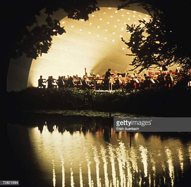 An orchestra gives a concert of classical music in the grounds of Kenwood House, London, circa 1975.