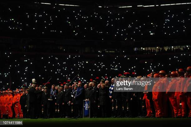 An orchestra performs as they honour 250 years of coal mining which is now closed down prior to the Bundesliga match between FC Schalke 04 and Bayer...