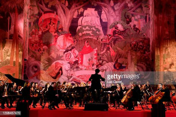 An orchestra performs during the Exhibition Opening of L'Exibition[niste] by Christian Louboutin as part of Paris Fashion Week Womenswear Fall/Winter...