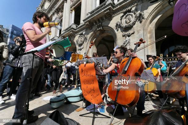 An orchestras playing in front of the Paris Opera during a protest dubbed a quotParty for Macronquot against the policies of the French president on...