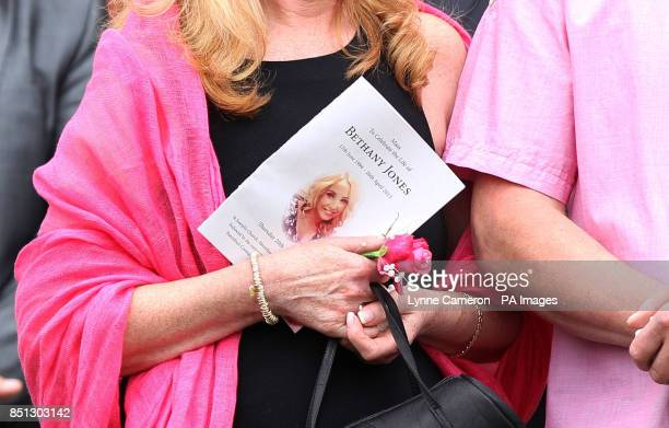 An order of service is shown in the hands of a mourner during the funeral Beth Jones who died in a crash on the M62 as she headed to a hen party at...