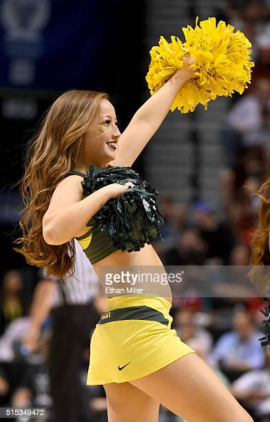 An Oregon Ducks cheerleader performs during the championship game of the Pac12 Basketball Tournament against the Utah Utes at MGM Grand Garden Arena...