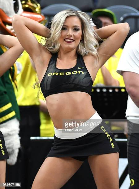 An Oregon Ducks cheerleader performs during the team's firstround game of the Pac12 basketball tournament against the Washington State Cougars at...