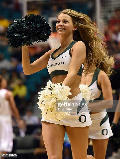 An Oregon Ducks cheerleader performs during the team's quarterfinal game of the Pac12 Basketball Tournament against the Washington Huskies at MGM...