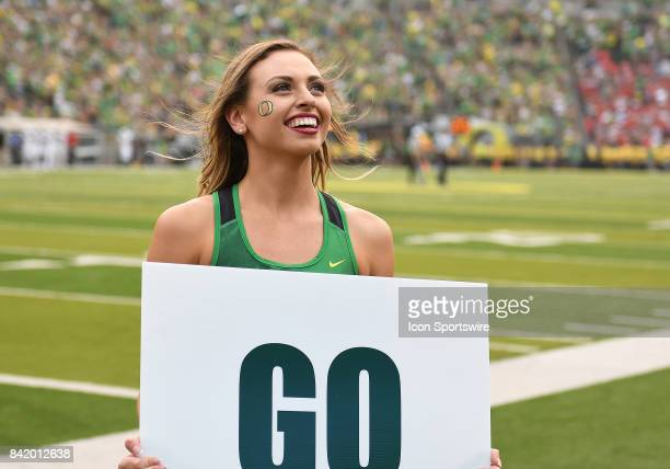 An Oregon Ducks cheerleader rallies the crowd during an NCAA football game between the Southern Utah Thunderbirds and Oregon Ducks on September 2 at...