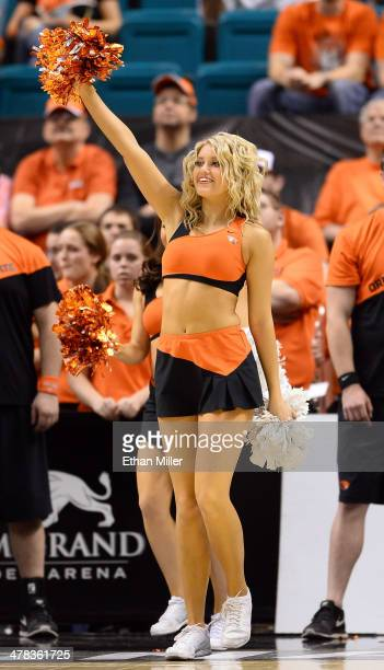 An Oregon State Beavers cheerleader performs during a firstround game of the Pac12 Basketball Tournament against the Oregon Ducks at the MGM Grand...