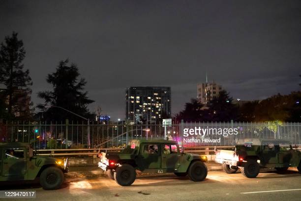 An Oregon State National Guardsman watches the crowd while dispersing black bloc protesters early in the morning on November 5, 2020 in Portland,...