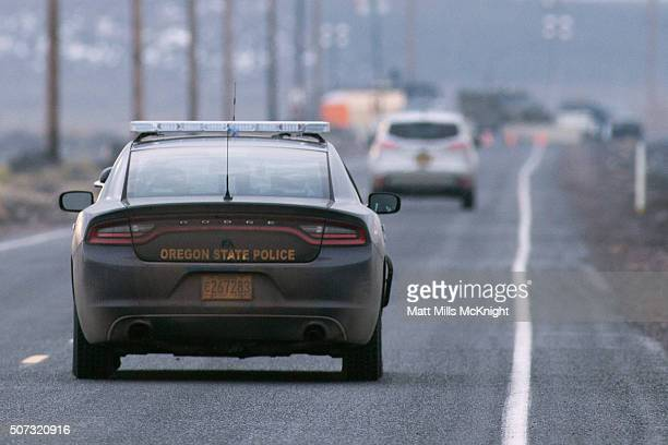 An Oregon State Trooper vehicle approaches a checkpoint on the Malheur National Wildlife Refuge January 28 2016 near Burns Oregon On January 26 eight...