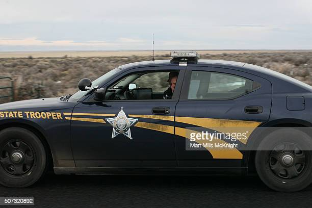An Oregon State Trooper vehicle drives on the road near a checkpoint at the Malheur National Wildlife Refuge January 28 2016 near Burns Oregon On...