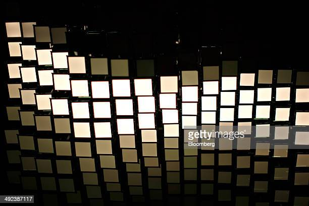 An organic lightemitting diode installation sits illuminated at Royal Philips NV's Lumiblade Creative Lab in Aachen Germany on Monday May 19 2014...
