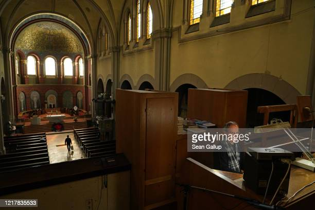 An organist plays at Saint Joseph Catholic Church prior to Easter during the coronavirus crisis on April 09, 2020 in Berlin, Germany. Many churches...
