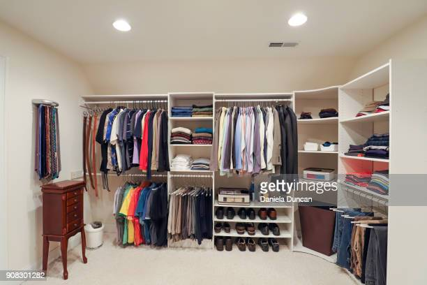 an organized man's closet - neat stock pictures, royalty-free photos & images