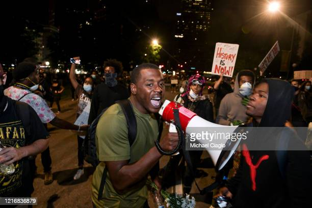 An organizer urges people to go home after a peaceful protest for the death of George Floyd on June 1 2020 in Denver Colorado Protests continue in...