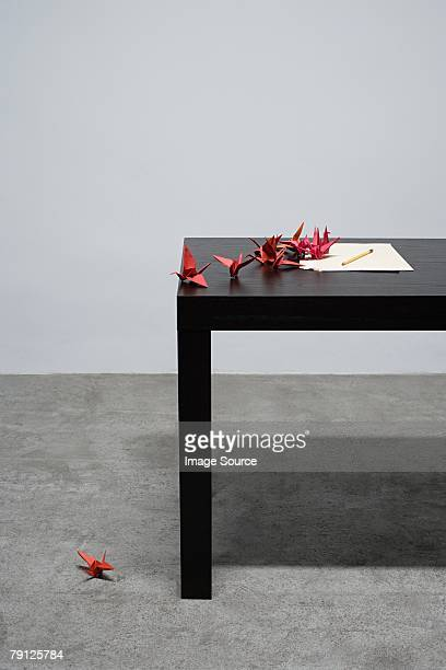 An origami bird fallen off a desk
