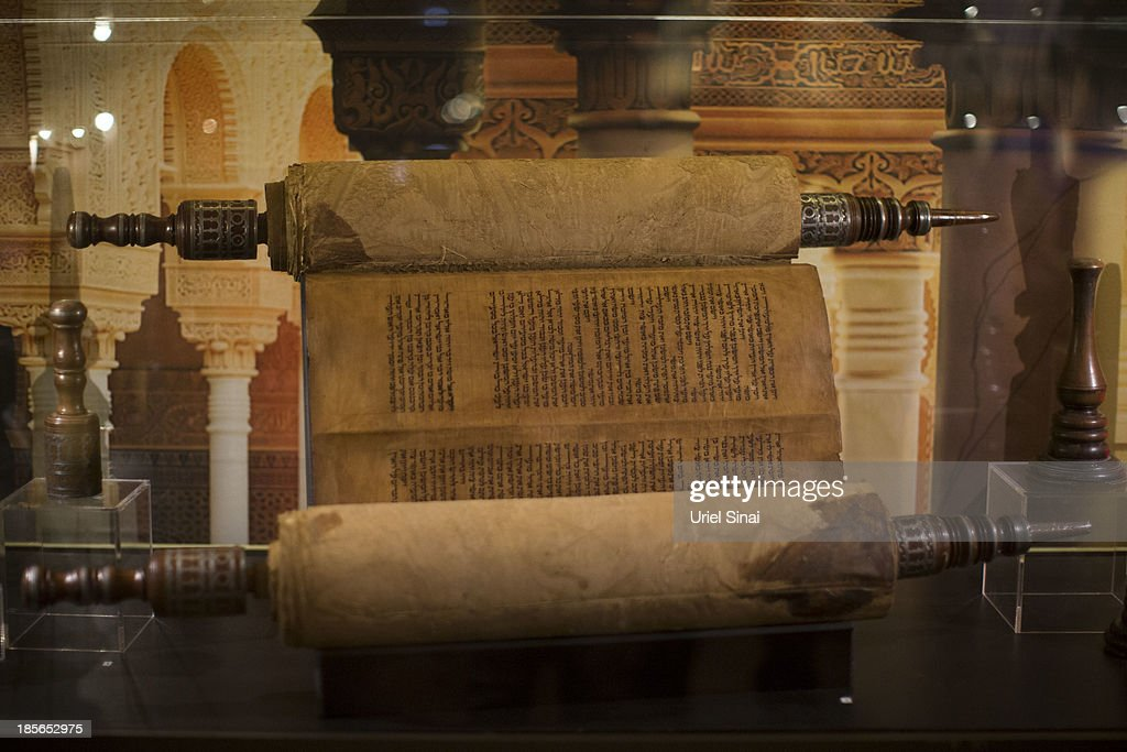 An original handwritten Torah scroll from the 17th centery, made in north Africa is displayed the 'Book of Books' exhibition in the Bible Lands Museum on October 23, 2013 in Jerusalem, Israel. The exhibition contains more than 200 of the rarest biblical manuscripts, including original fragments from the Septuagint and the earliest New Testament Scriptures. This exhibition opened in Israel before heading to the Vatican and ends in Washington D.C, where it will be permanently displayed.