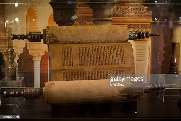 An original handwritten Torah scroll from the 17th centery made in north Africa is displayed the Book of Books exhibition in the Bible Lands Museum...