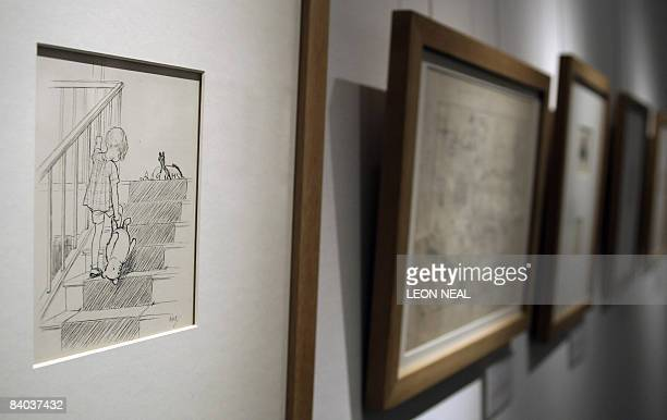 An original illustration of WinniethePooh entitled 'Bump bump bump going up the stairs' by EH Sheppard is displayed at Sotheby's auction house in...
