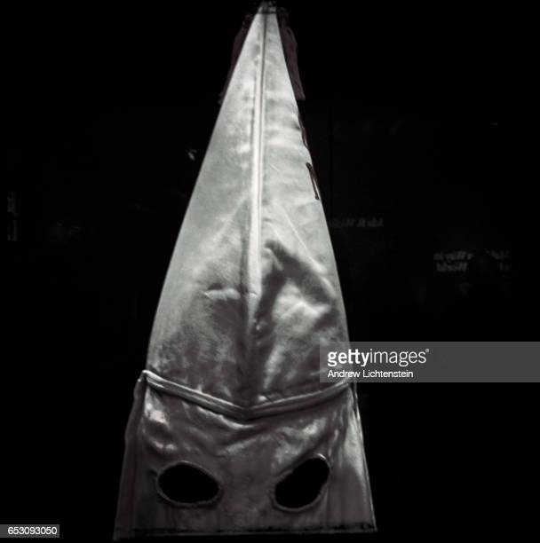 An original Ku Klux Klan mask is part of an exhibit at the Smithsonian's Museum of African American Culture and History on January 19 2017 in...