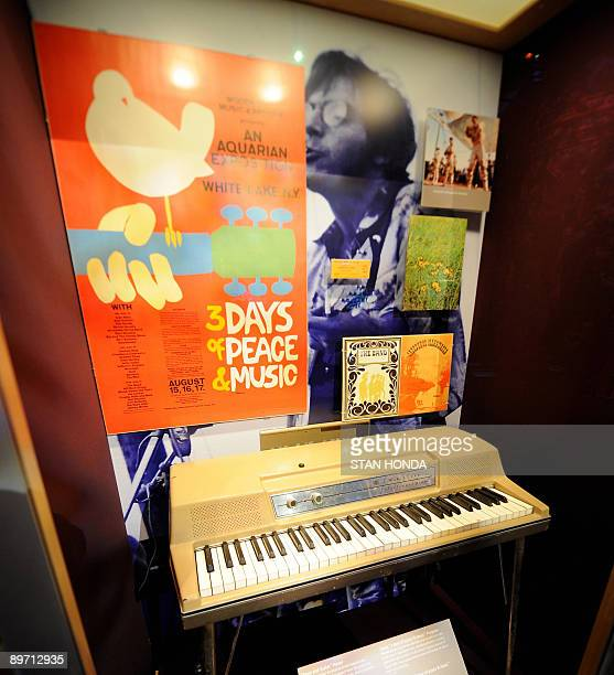 STORIES USMUSICSOCIETYHISTORYWOODSTOCK An original promotional poster designed by Arnold Skolnick and an electric piano used by Sha Na Na member...