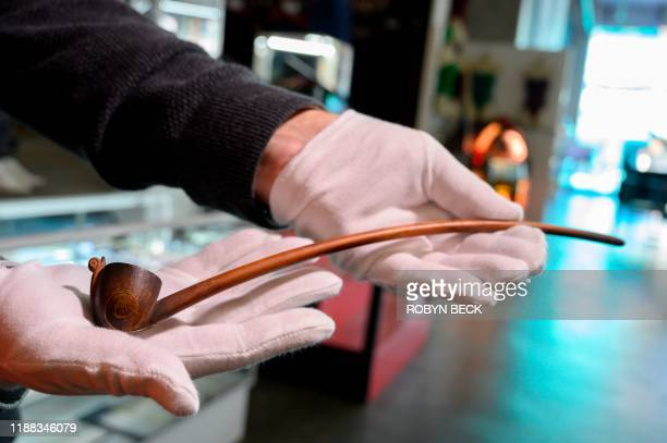 "An original tobacco pipe used by actor Ian Holm as the hobbit Bilbo Baggins in the 2001 film ""The Lord of the Rings: The Fellowship of the Ring"" is..."